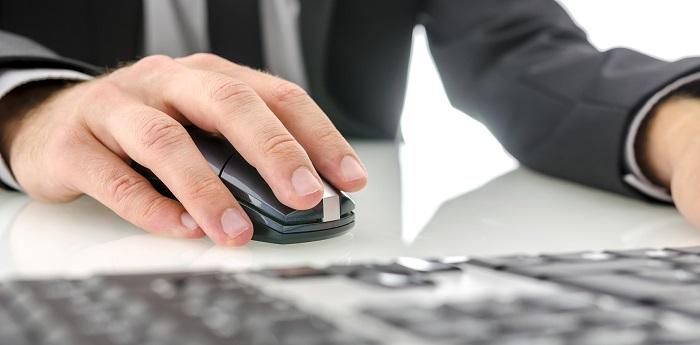 Closeup of businessman using office computer.